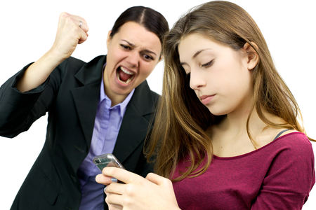 Unhappy woman about daughter addicted to cell phone photo