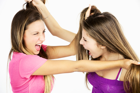 angry people: Angry girls fighting holding hair