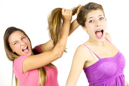 catfight: Scared girl fighting with friend