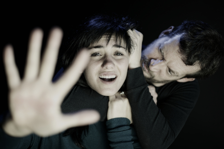 strangling: scary man strangling a young woman who ask for help