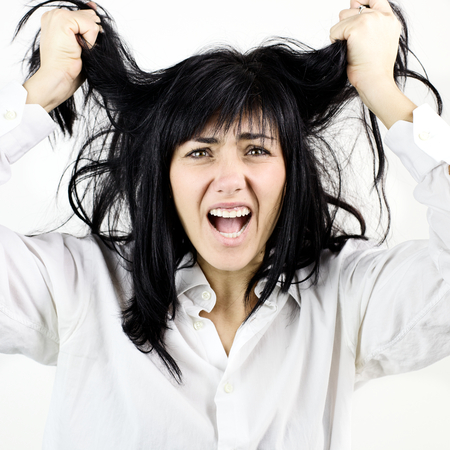 bad hair day: woman desperate about her hair,unable to stylish them.