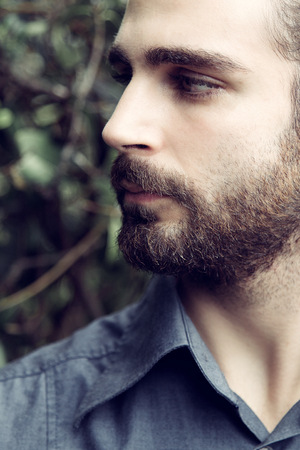 cool man: profile of cool man with beard looking at something