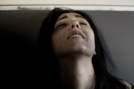 battered woman: Sad woman crying after violence