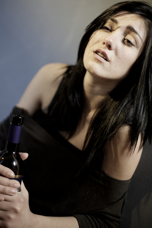 drunk woman: unhappy lost drunk woman sad sitting in street at night