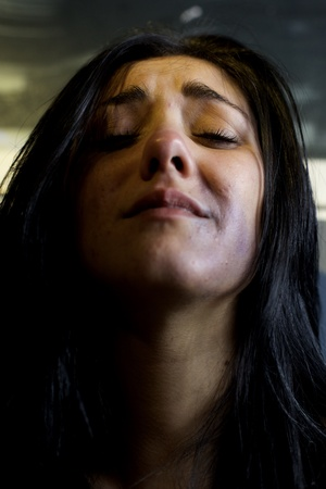 bruised: Sad woman crying after violence