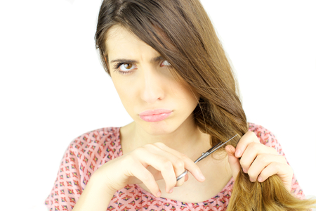 cut off head: Woman ready to cut her long hair Stock Photo