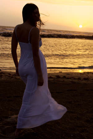 woman sunset: Lady with white dress in front of sunset
