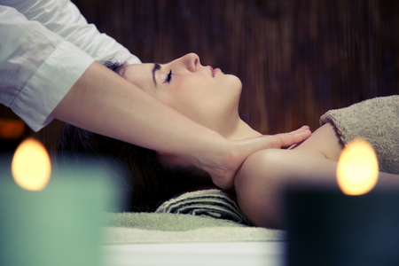 Beautiful woman getting shoulder massage in spa