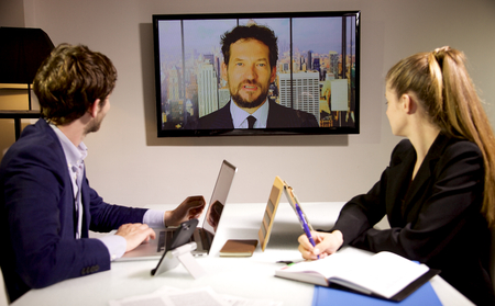 Business man and woman talking with boss in conference call