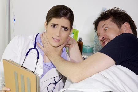 funny scene of a patient who wants to strangle female doctor
