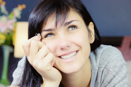 Happy woman thinking about love Stockfoto