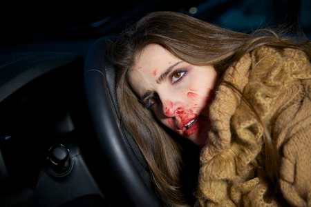 Woman with blood in face dead in car