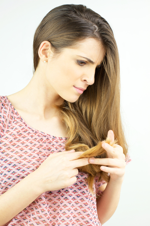 Cute woman with ruined long hair