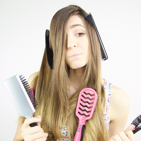 Cute female model with comb in hair looking serious