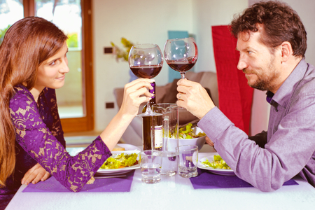 Couple in love toasting with red wine