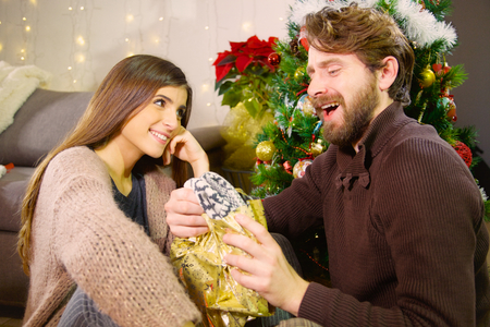 Cute young couple happy in winter at home for christmas