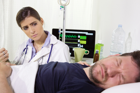 sad doctor worried about patient Stockfoto