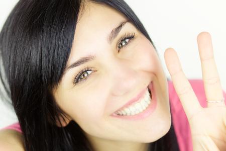 cute young woman smiling looking at camera
