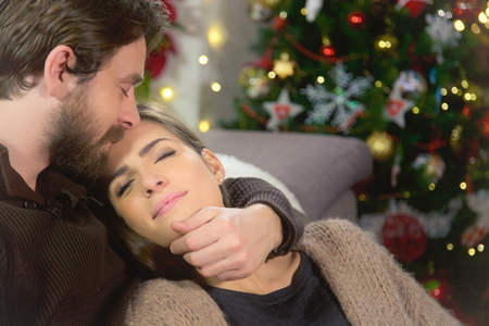 Cute happy couple in love during Christmas Stockfoto