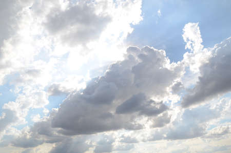 White clouds cumulus floating on blue sky with sunlights on background