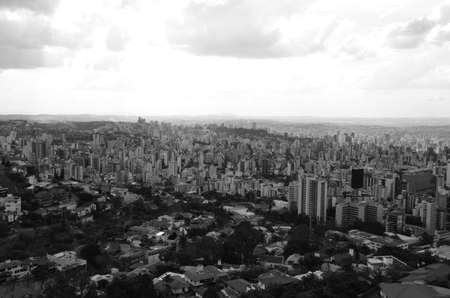 Landscape of the city of Belo Horizonte, State of Minas Gerais, Brazil at a sunny day with blue sky at 3pm in the spring in black and white Imagens