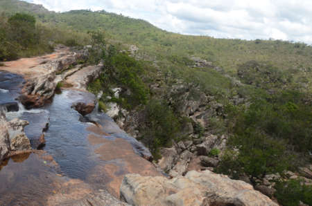 Top of the Waterfall in Milho Verde in the state of Minas Gerais called Cachoeira do Moinho (translated to Watermill Waterfall)