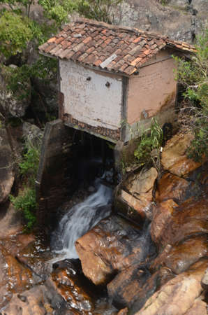Watermill in Milho Verde in the state of Minas Gerais at Cachoeira do Moinho (translated to Watermill Waterfall) Imagens