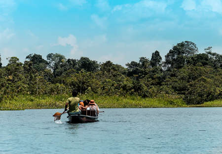 river in the middle of the Amazon with abundant vegetation 스톡 콘텐츠
