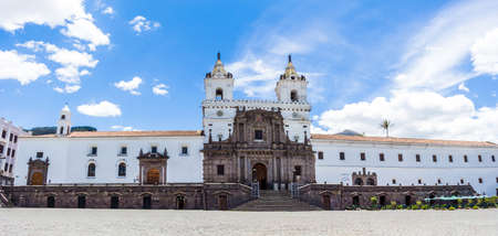 Panning shot of the Church of San Francisco in the middle of the square under the blue sky of the historic center of Quito Ecuador
