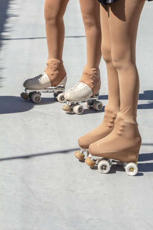 Legs of two skaters on a figure skating rink Roller skates and tights Stockfoto