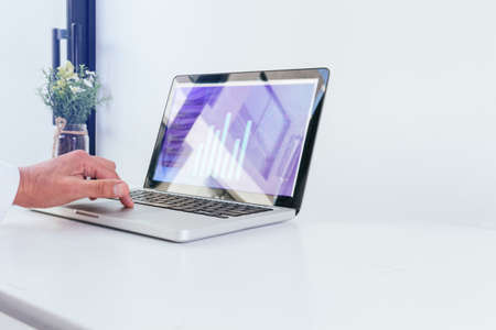 Close-up of a hand on your laptop pad with image on your screen in a white office with ample copy space