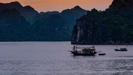 Vietnam Halong Bay boat tour view on sunset