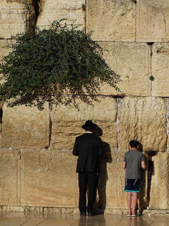 Israel Jerusalem Western Wall father and son praying 스톡 콘텐츠