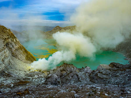 Moiunt Ijen Volcano view with sulfur an the toxic blue lake on Java Indonesia