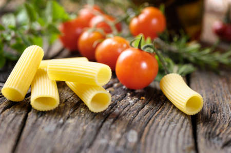 ridged: Raw rigatoni pasta with herbs