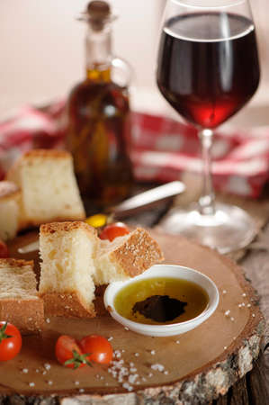 balsamic: Oil and vinegar - small bowl of olive oil and balsamic vinegar, with dipping bread and fresh