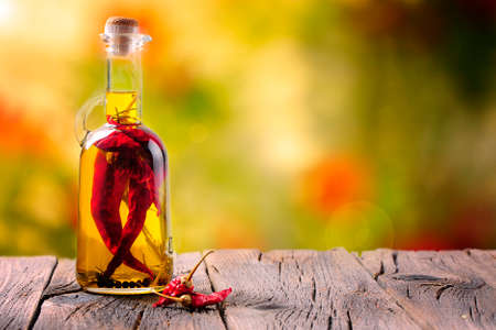 Olive oil with chilli pepper photo
