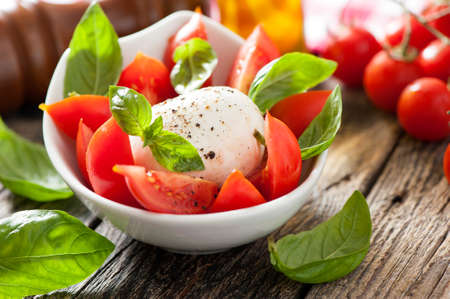 caprese: fresh caprese salad in bowl