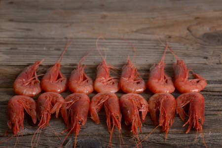 aphrodisiac: tiger shrimps on wooden background