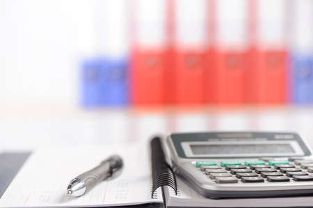 efficacy: Office background with table, calculator and pen Stock Photo
