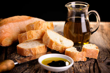 Italian food appetizer of bread olive oil and balsamic vinegar Imagens