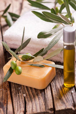 oil massage: Natural spa setting with olive and olive oil products bath salt