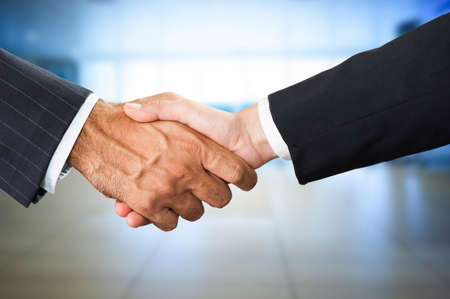 business sign: Handshake two business partners