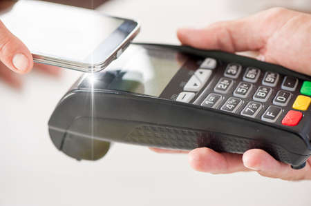 consumerism: payment through a terminal with credit card Stock Photo