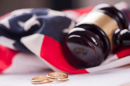 gavel: Wedding Rings And Wooden Gavel Stock Photo
