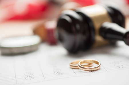 gold ring: Wedding Rings And Wooden Gavel Stock Photo