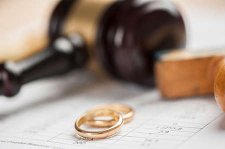 Wedding Rings And Wooden Gavel Archivio Fotografico