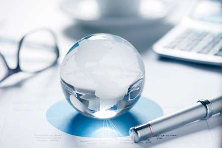 Glass globe  and business papers