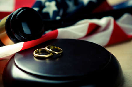 divorce: Wedding Rings And Wooden Gavel Stock Photo