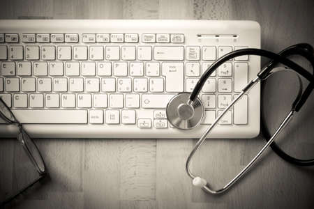 stethoscope and a computer keyboard